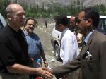 Shaking hand with Secretary Ismaili Local Coucil Gulmit