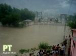 Men watching the raging flood storm