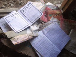 Books scattered at a deserted house