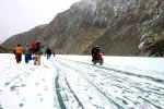 A biker speeds on the thick ice-sheath covering the Attabad landslide triggered lake in Gojal Valley