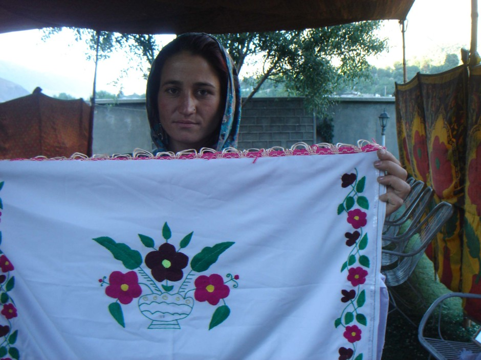 Chitral: An artisan displaying her handicraft