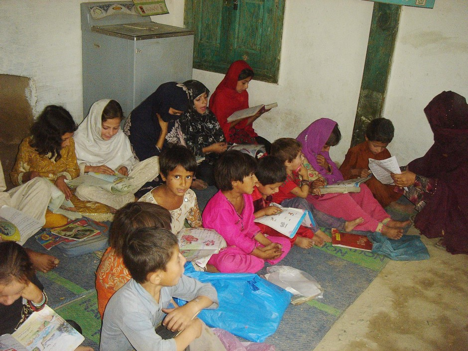 Students studying in a miserable environment at Drosh Community school operated by National Education Foundation