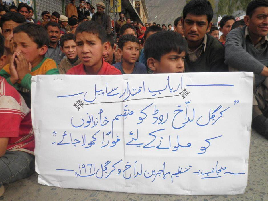 """Refugees demand opening of the Skardu - Kargil road during a protest demonstration in Skardu city, Baltistan. """"Open the road immediately to reunite the divided families of Kargil and Ladakh"""", the placard reads. The demonstration was organized by a committee of the refugees. Source: Zahid Mukhtar/Online"""